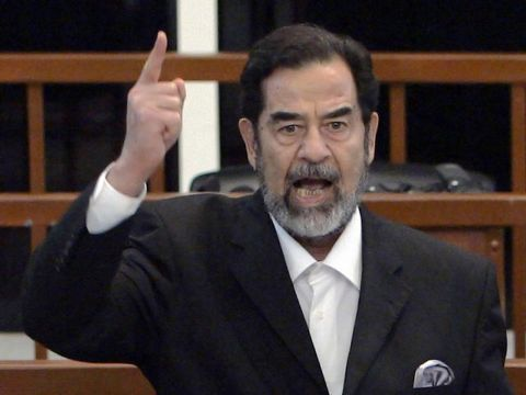 Former Iraqi president Saddam Hussein yells at the court as the verdict is delivered during his trial held under tight security in Baghdad's heavily fortified Green Zone, Sunday Nov. 5, 2006. Iraq's High Tribunal on Sunday found Saddam Hussein guilty of crimes against humanity and sentence him to die by hanging. (AP Photo/David Furst, Pool)