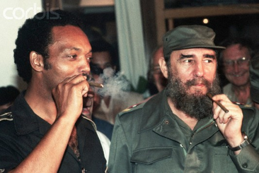 June 26-27, 1984, Havana, Cuba --- Jesse Jackson smokes Cuban cigars with Fidel Castro during a controversial visit to Havana in June 1984. Jackson, a candidate for President of the United States, caused a stir in the U.S. government and press by visiting with the Communist leader. --- Image by © Jacques M. Chenet/CORBIS