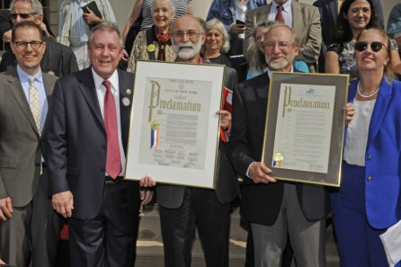 9/28/15 Robert Meeropol (pictured, pink shirt) and his brohter, Michael Meeropol, (pictured, blue shirt) received a proclamation from City Council member Daniel Dromm today. The proclamation recognized the contributions to the labor movement of Ethel Rosenberg, the mother of Robert and Michael. She was convicted of espionage along with her husband Julius in 1953 and was sentenced to death. Today would have marked her 100th birthday. Pictured, left to right: City Council member Mark Levine, City Council member Daniel Dromm, Robert Meeropol, Michael Meeropol and Gail Brewer. On the steps of City Hall, NY, NY . Please credit Gregory P. Mango.