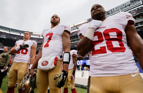 kaepernick standing for anthem in 2014